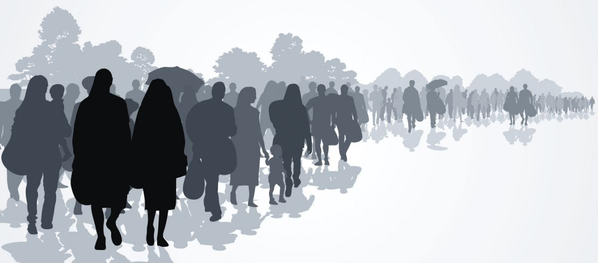 Silhouettes of refugees people searching new homes or life due to persecution